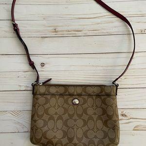 Coach cross body purse or shoulder bag.